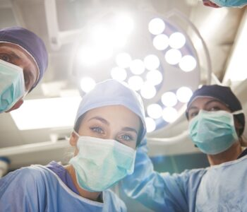 low-angle-view-of-surgeons-over-the-operating-tabl-NL8ENSJ (3) (1)
